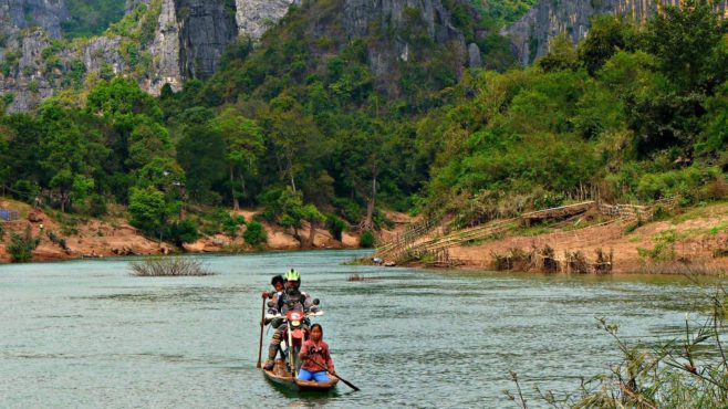 moto-crossing-river-on-ferry-historical-adventure-tour