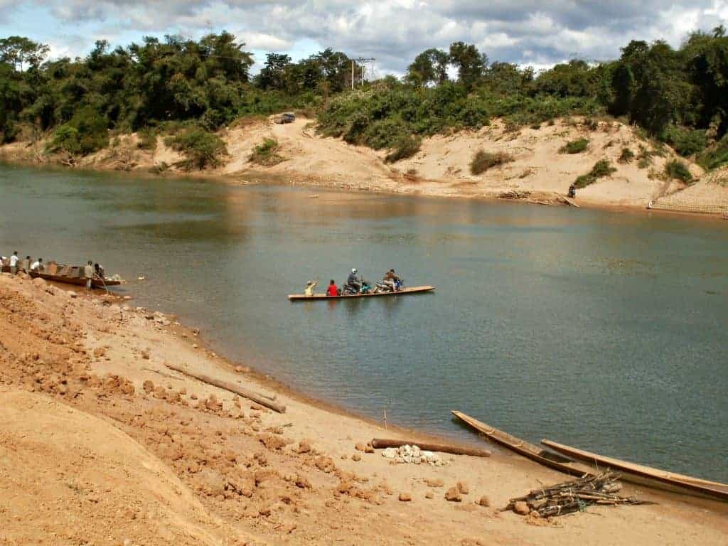river-crossings-Laos-Ho-Chi-Minh-Trail-small-ferry-used-for-crossing