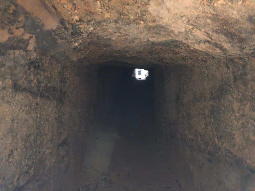 standing-inside-nva-tunnel-ho-chi-minh-trail-laos-xepon-area-looking-into-the-tunnel