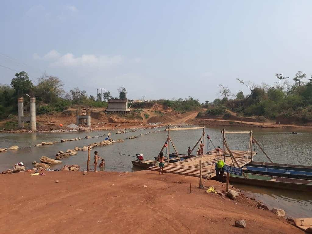 river-crossings-Laos-Ho-Chi-Minh-Trail-ferry-operational-bridge-damaged-by-water