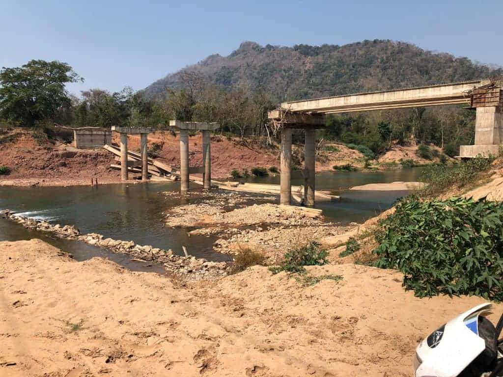 river-crossings-Laos-Ho-Chi-Minh-Trail-incomplete-bridge-flooded-ford